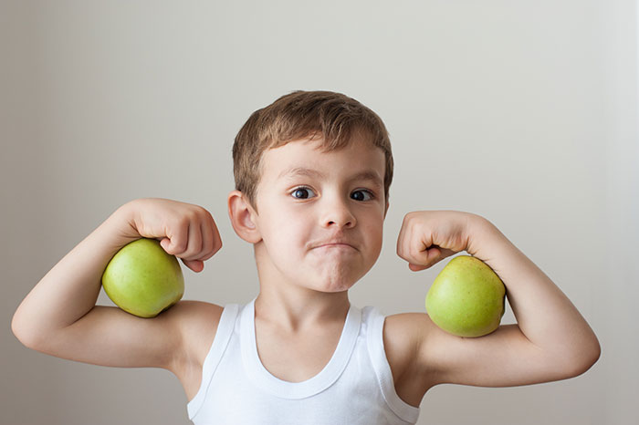 young male flexing muscles